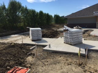 Concrete paths in progress at The Ganzhorn Suites
