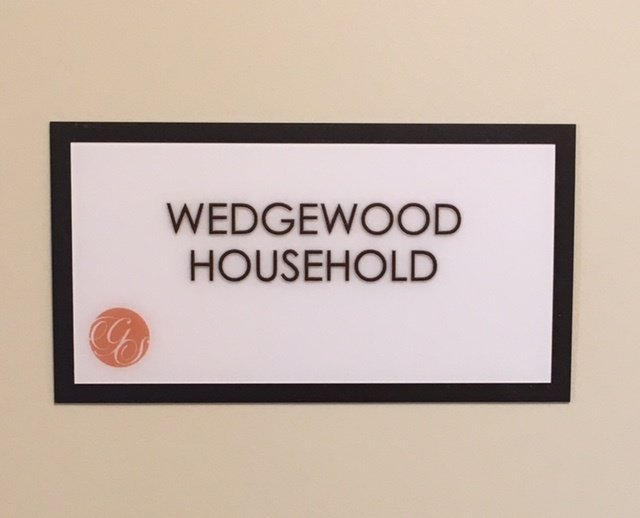 Sign for the Wedgewood Household in our assisted living center